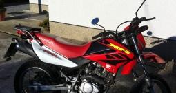 Prodajem kombinirani cestovno - enduro motor marke Honda